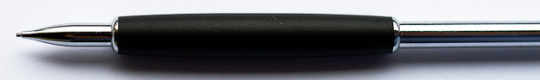 The grip is only slightly narrower than a wood-cased pencil