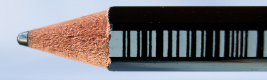 The pencil will rest on the shoulders created by the sharpener, which makes it impossible to sharpen any further.