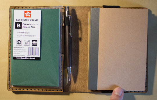 Size comparison: a Banditapple Peewee and an A6 notebook