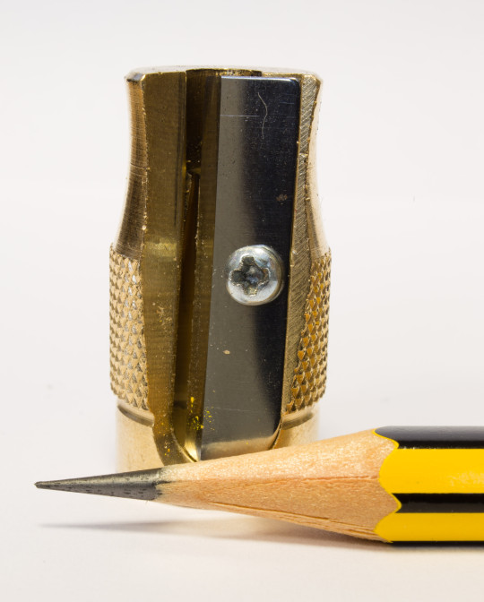 A pencil point after the blade treatment