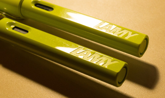 real: bottom, fake: top - the pattern in the fake LAMY letters is shallower and there are lines