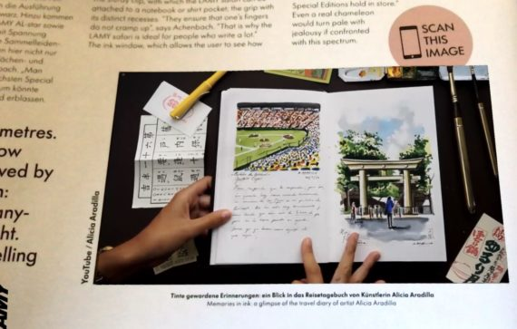 The AR app shows a video of someone flicking through diary pages where the magazine shows a photo.